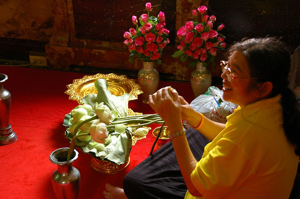 Woman Preparing Lotus Flowers - Bangkok, Thailand