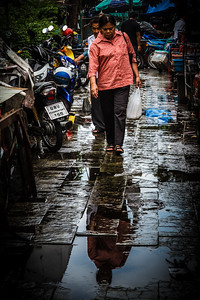 What an amazing reflection in this street market life scene.
