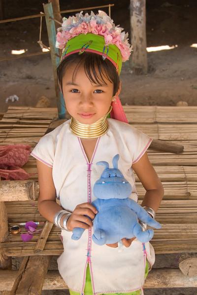 Long Neck girl holding skull - Chiang Mai, Thailand
