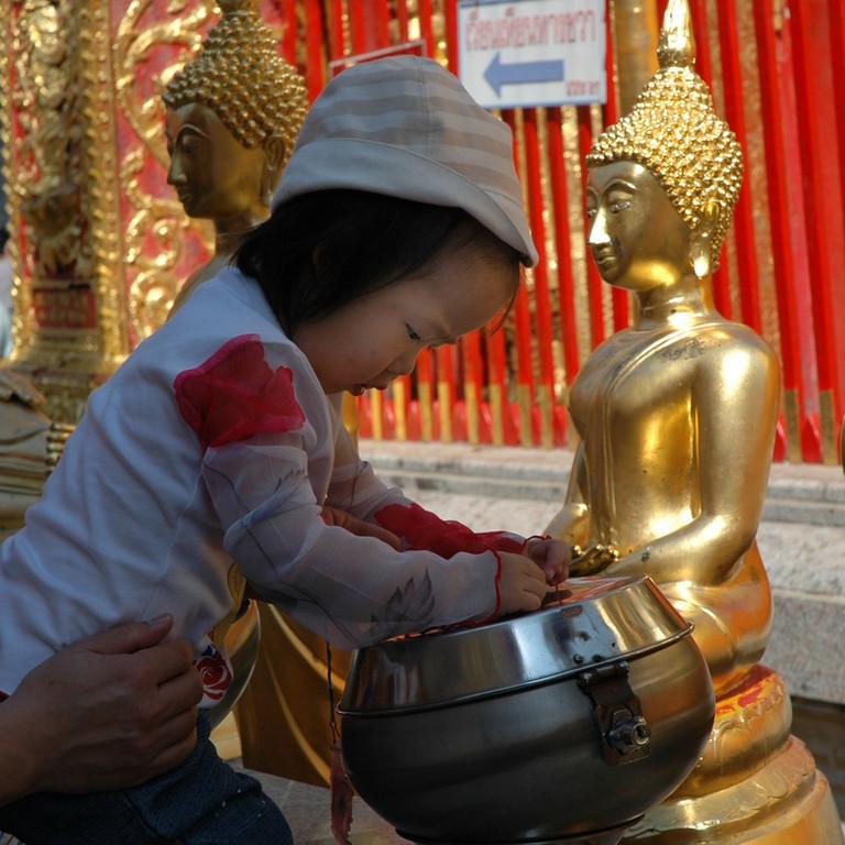 Child with a Buddha - Chiang Mai, Thailand