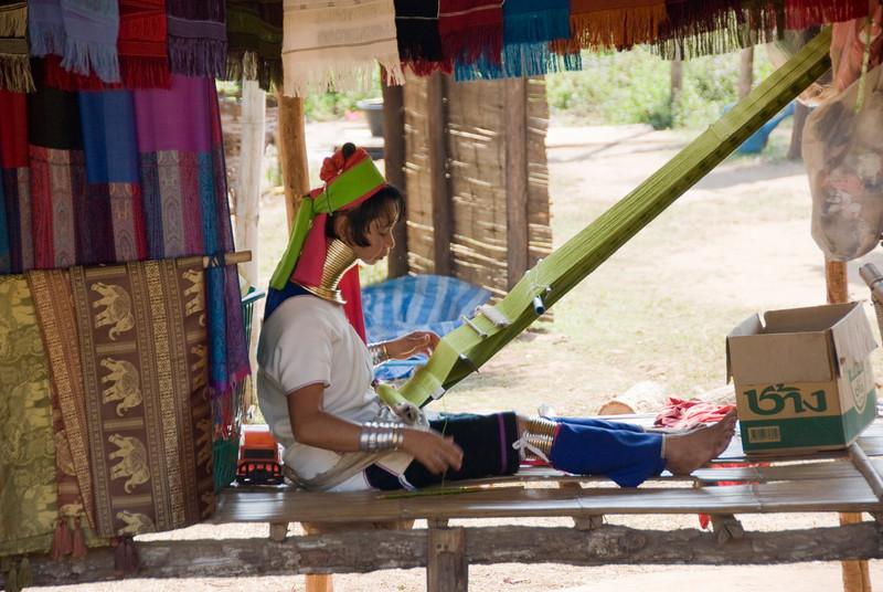 Kayan woman weaving in Chiang Mai, Thailand