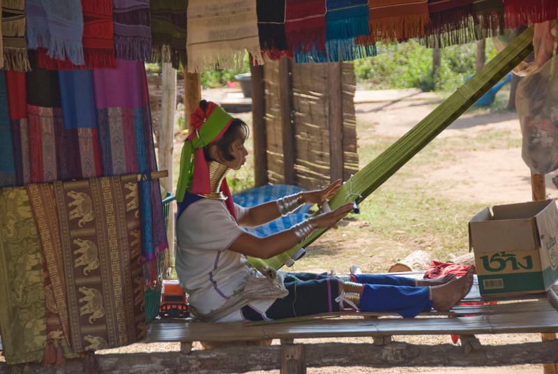 Long neck woman weaving in Chiang Mai, Thailand