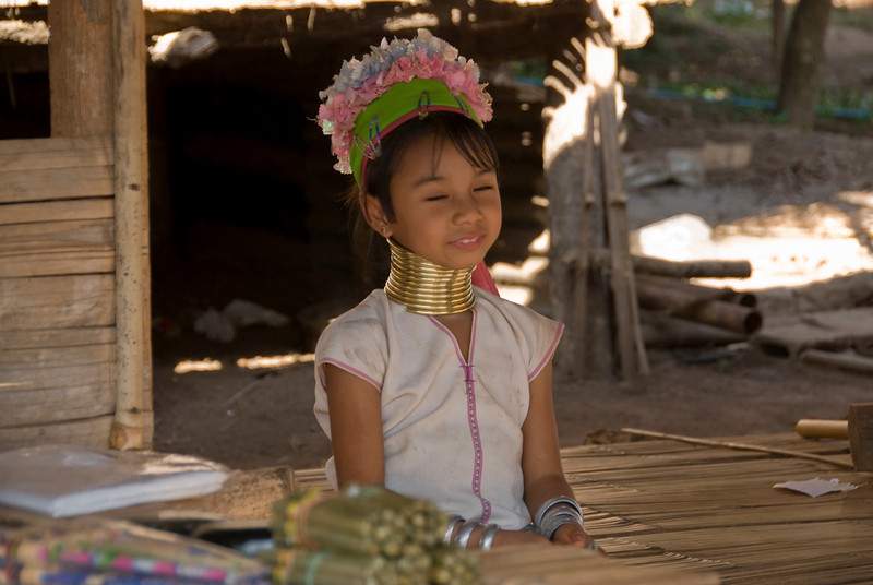 Profile of Kayan girl with head ornaments - Chiang Mai, Thailand
