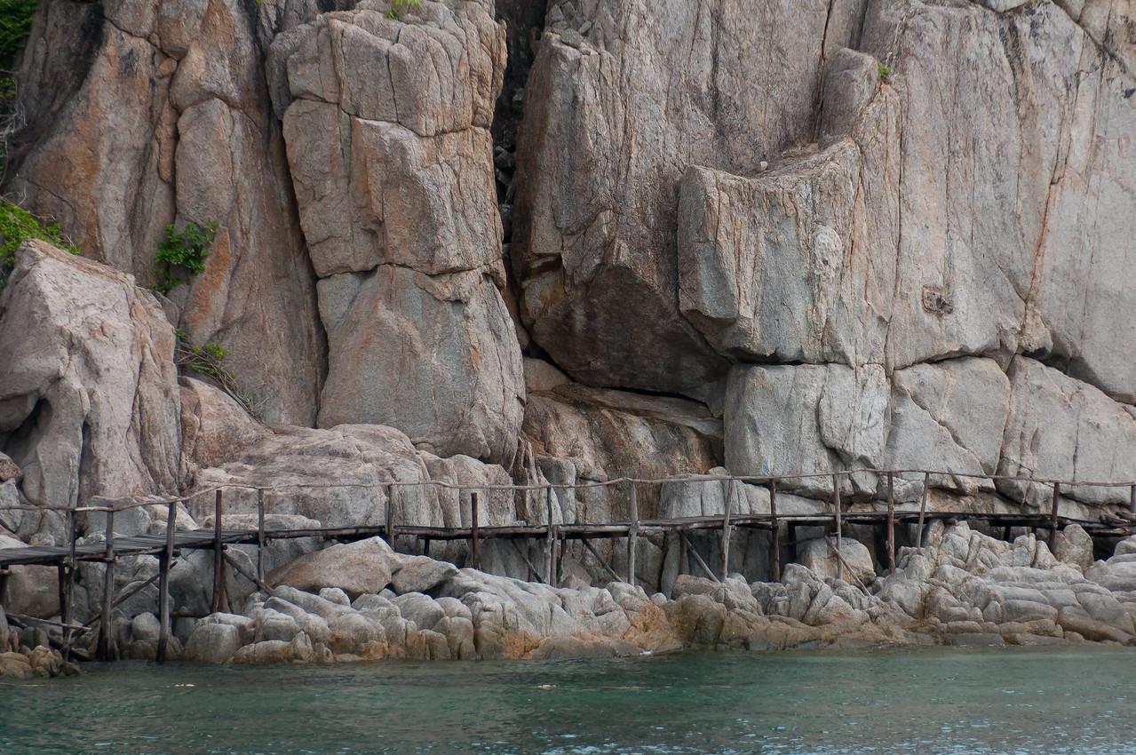 Wooden bridge along rock formation in Ko Samui, Thailand