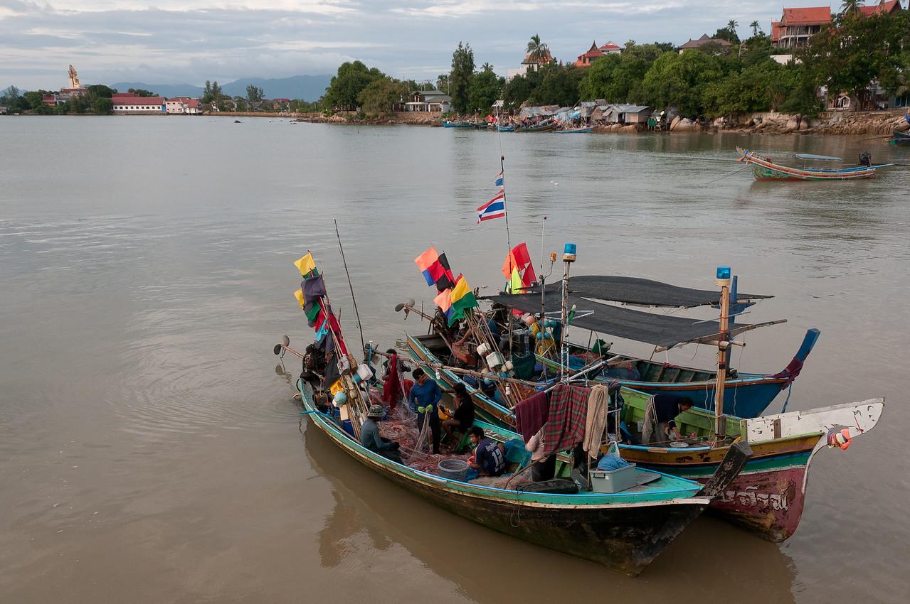 Fishing boats setting out into the sea at Ko Samui, Thailand