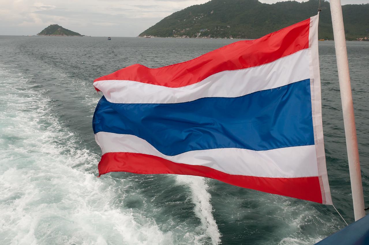 The Thai national flag waving on a boat - Ko Samui, Thailand
