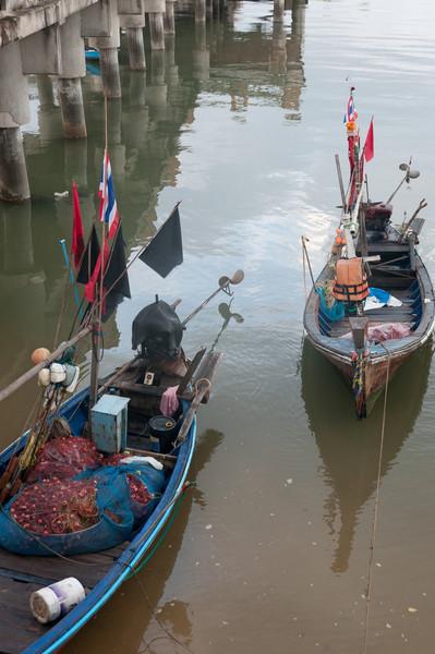 Two small fishing boats on dock at Ko Samui, Thailand