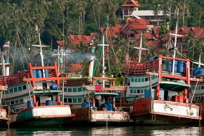 Large fishing boats side by side on dock - Ko Samui, Thailand