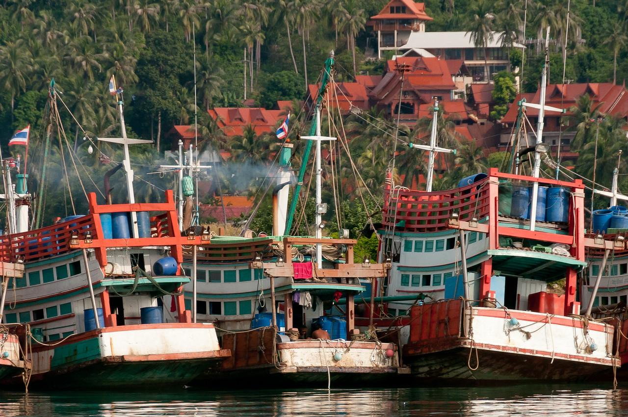 Large fishing boats side by side on dock - Ko Samui, Thailand