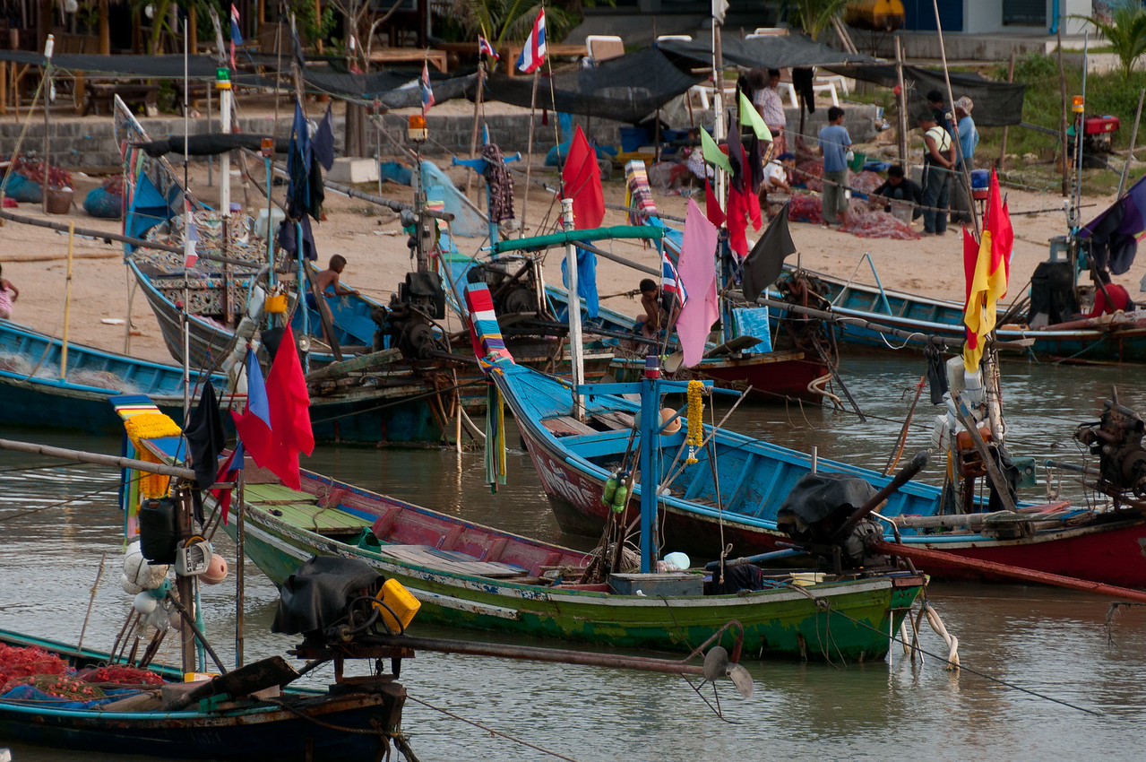 Fishing boats docked at the shore in Ko Samui, Thailand