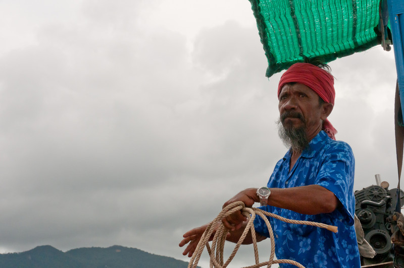 Man on boat in Ko Samui, Thailand