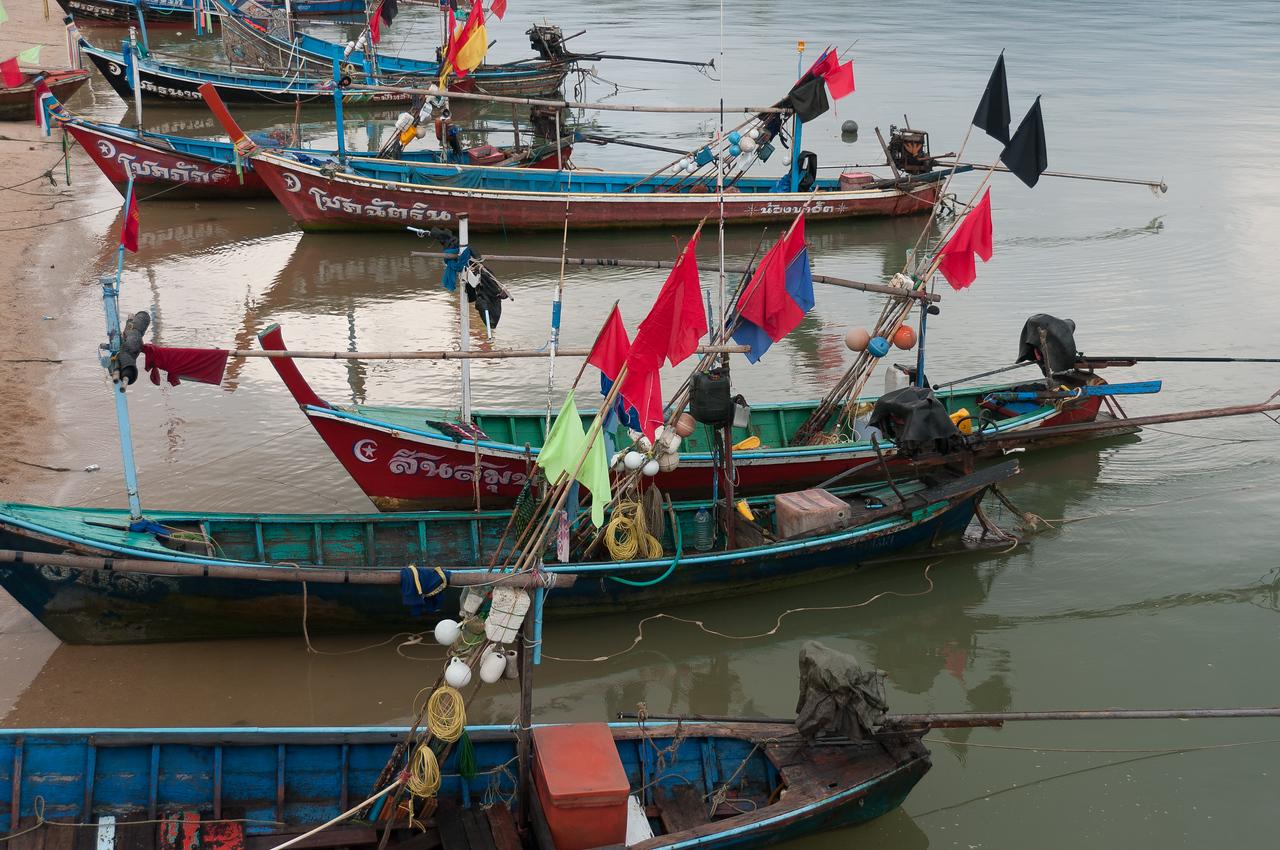 Colorful flags and fishing boats at Ko Samui, Thailand
