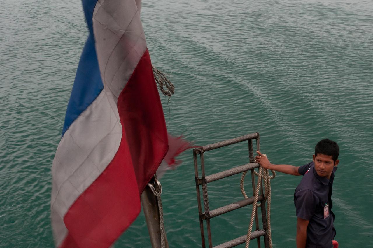 Shot of a man and Thai national flag - Ko Samui, Thailand