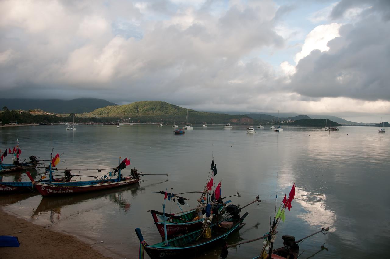 Wide shot of small fishing boats on dock at Ko Samui, Thailand