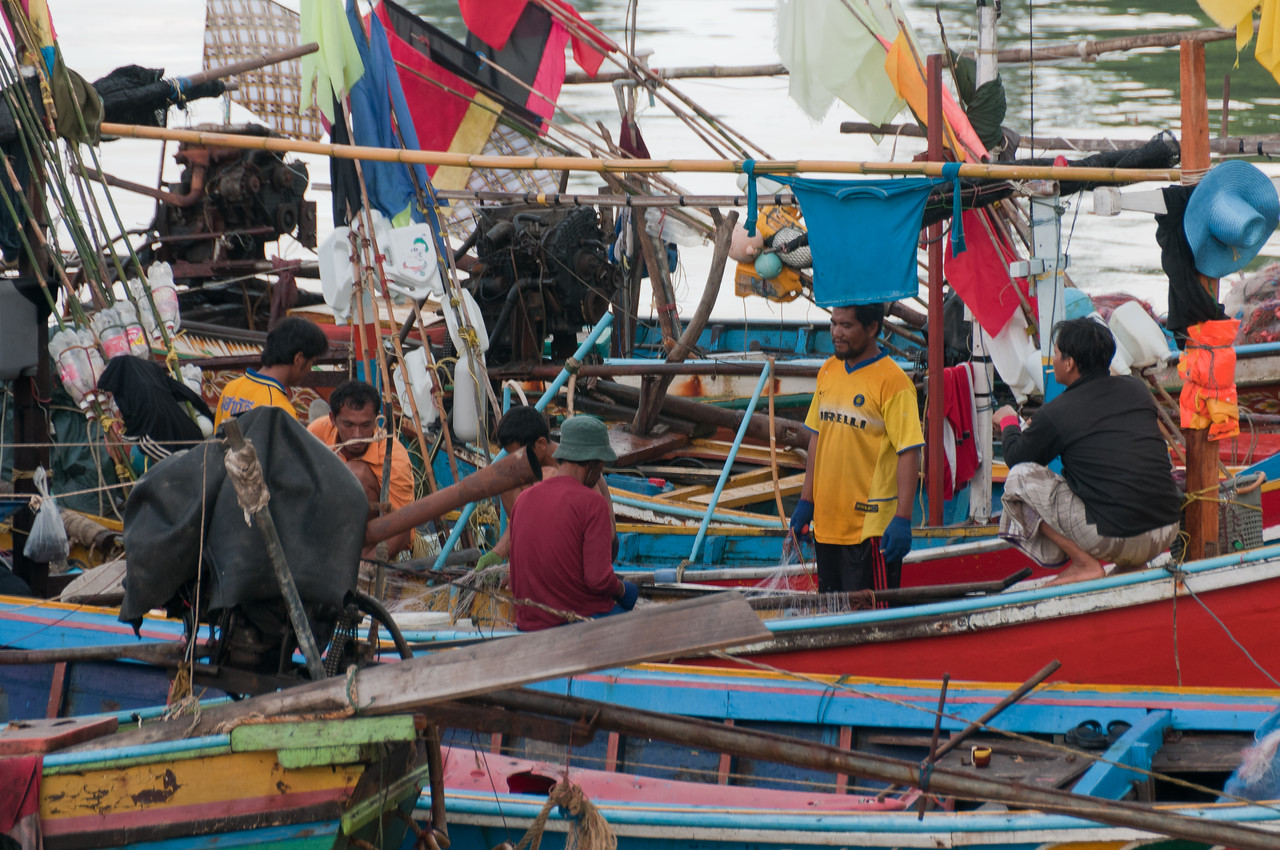 Fishermen on a boat in Ko Samui, Thailand