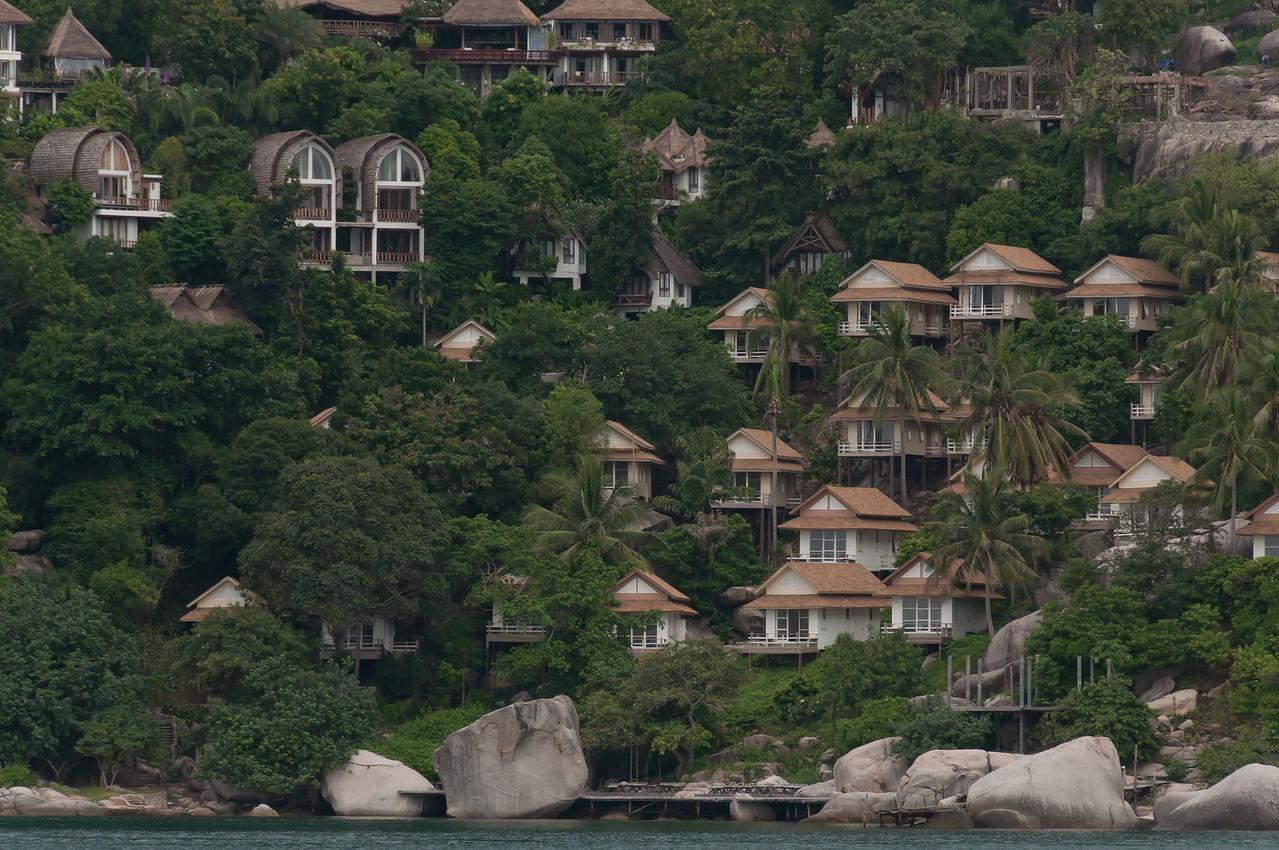 Closer shot of resort huts on hillside at Ko Samui, Thailand