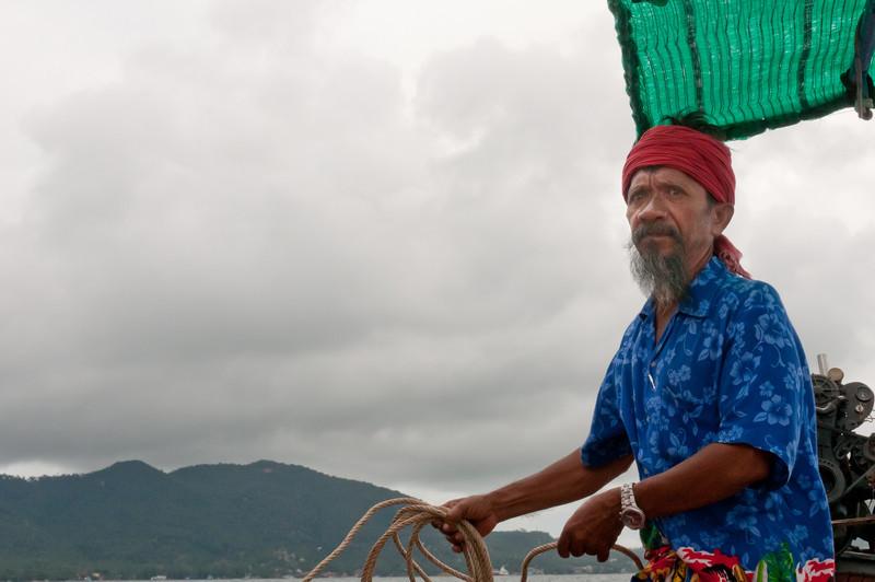 Man navigating the boat in Ko Samui, Thailand