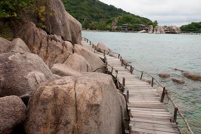 Crooked wooden bridge near rock formation in Ko Samui, Thailand