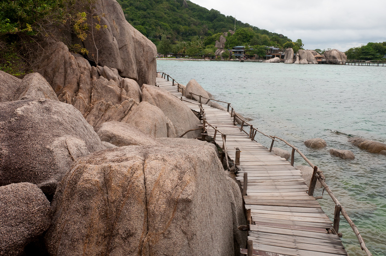 Crooked wooden bridge near rock formation in Ko Samui, Thailand