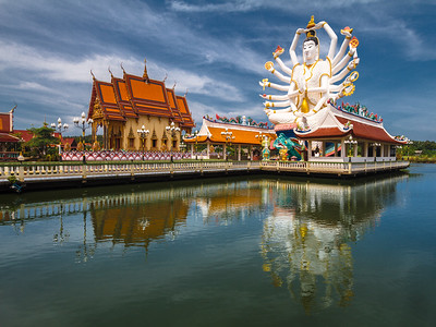 The intriguing Wat Plai Laem Temple showing here Guanyin, the Chinese Goddess of Mercy and Compassion who has 18 arms.