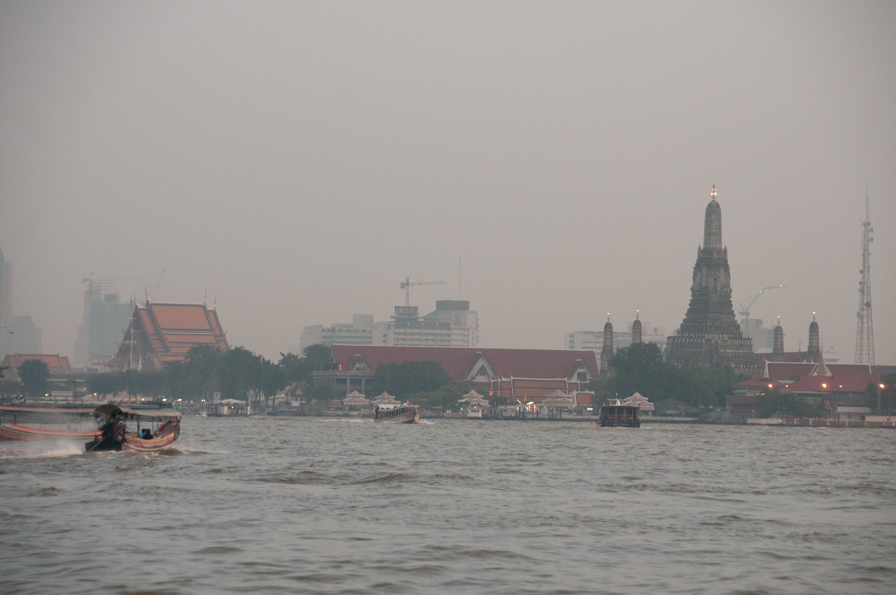 River and a foggy view of the city skyline in Thailand