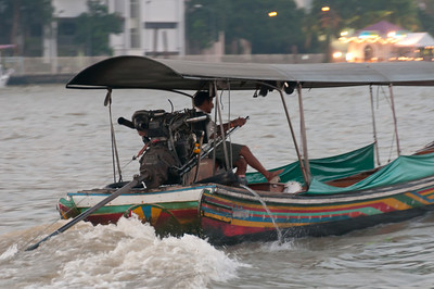 Motor-powered boat cruising on the river at Thailand