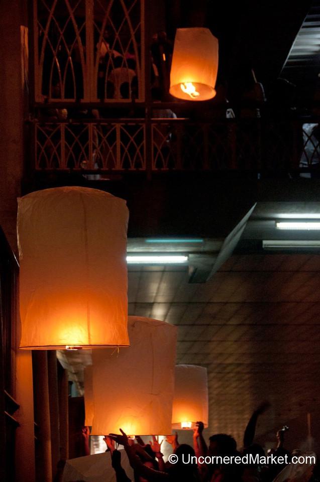 Lighting Paper Lanterns for Loi Krathong Festival in Bangkok, Thailand