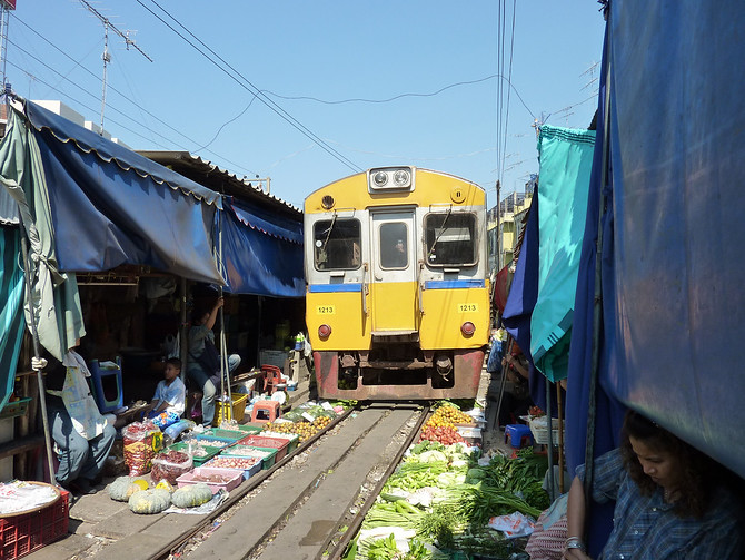 Train passing through market - Maeklong Thailand