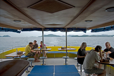 Tourists in the diving boat top deck in Phuket, Thailand