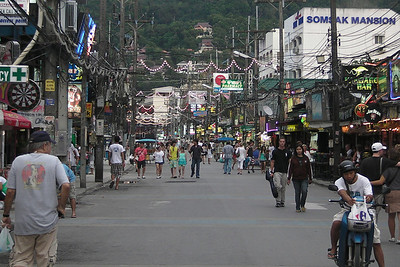 Locals and tourists in the street of Patong -  Phuket, Thailand