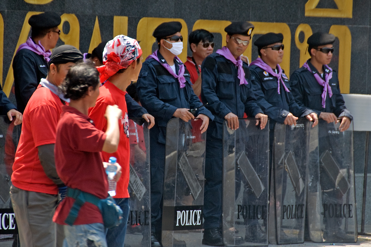 Protesters and riot police at protest, Bangkok, Thailand