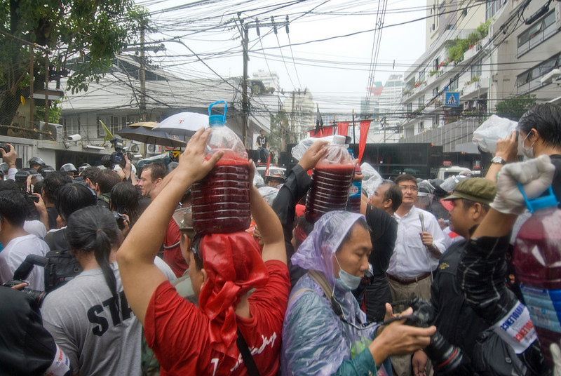 Protesters wet from rain during the Red Shirt Protest
