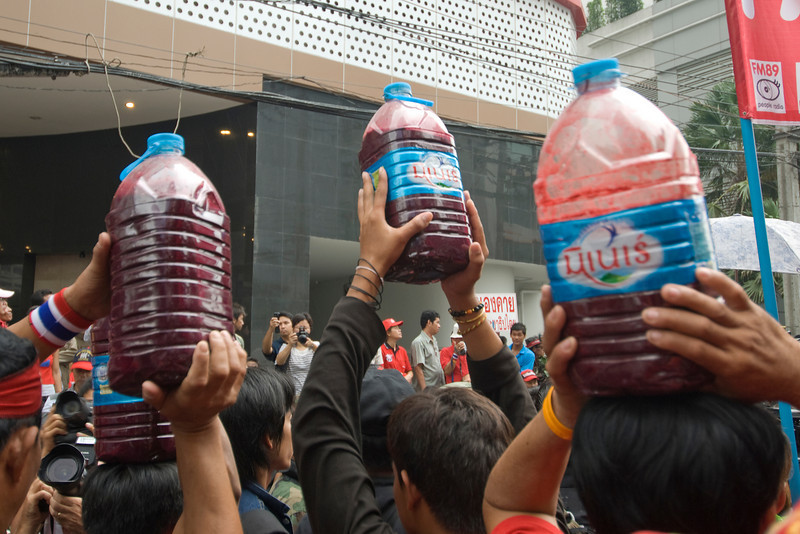Closer shot of water bottles with dyed water during Red Shirt Protest