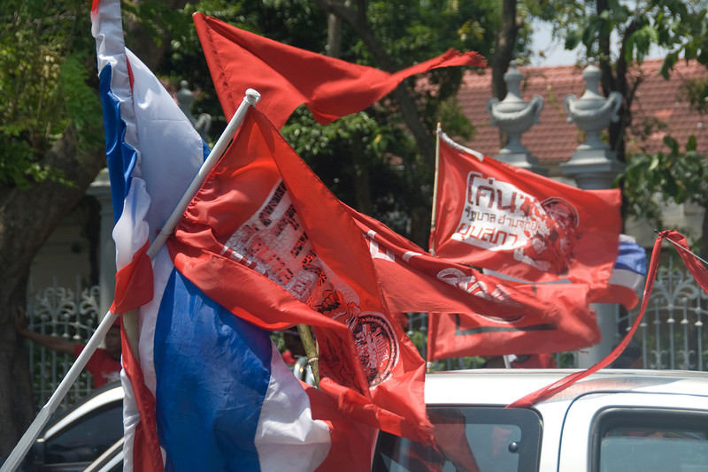 Close-up of national and protest flags during Red Shirt Protest in Thailand
