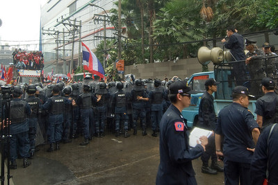 Rain beating down on riot police and protesters during Red Shirt Protest