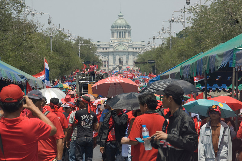 Large crowd of Red Shirt protesters with flags