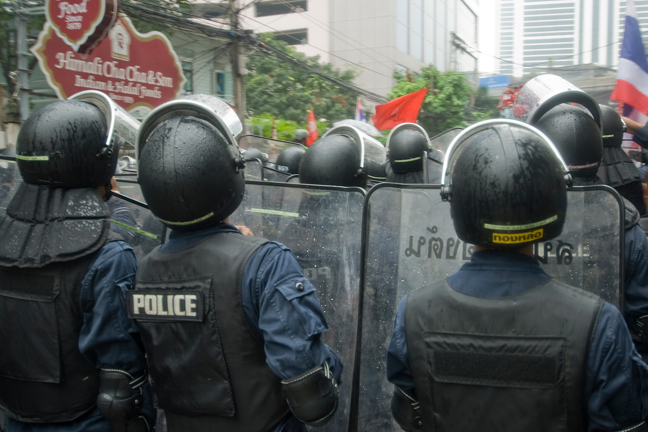 Riot police carrying shields during Red Shirt Protest - Thailand