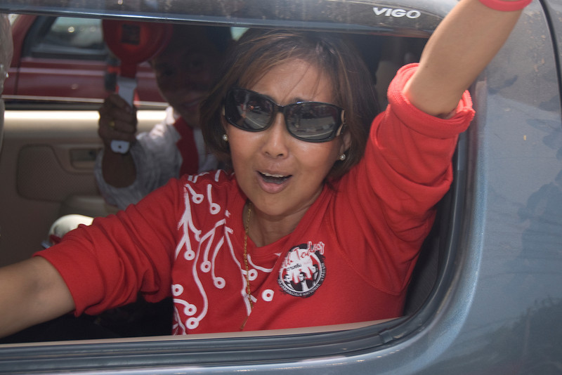 Woman smiling from inside the vehicle during Red Shirt Protest - Thailand