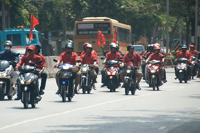 Men riding motorcycles as part of Red Shirt Protest activity in Thailand