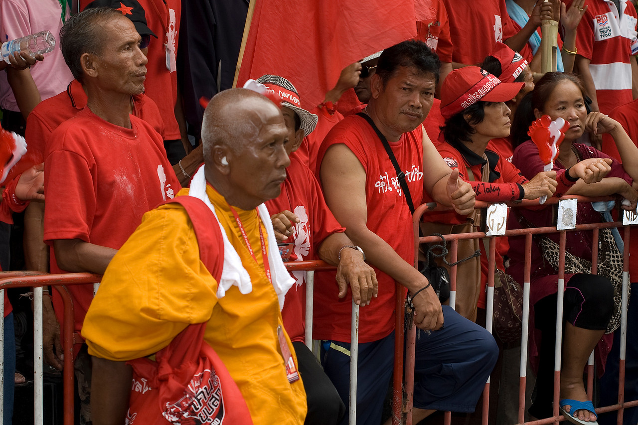 Protesters leaning on rails during Red Shirt Protest in Thailand