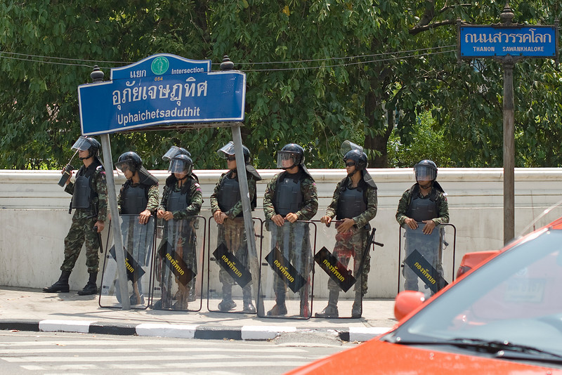 Riot police on guard during the Red Shirt Protest in Thailand