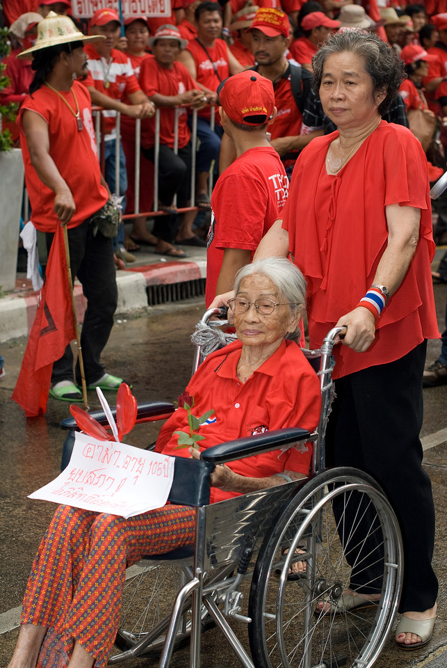 Old woman on wheelchair joins the Red Shirt Protest in Thailand