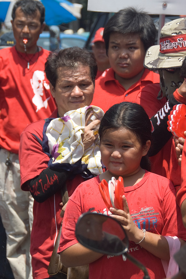 A child joining the Red Shirt Protest in Thailand