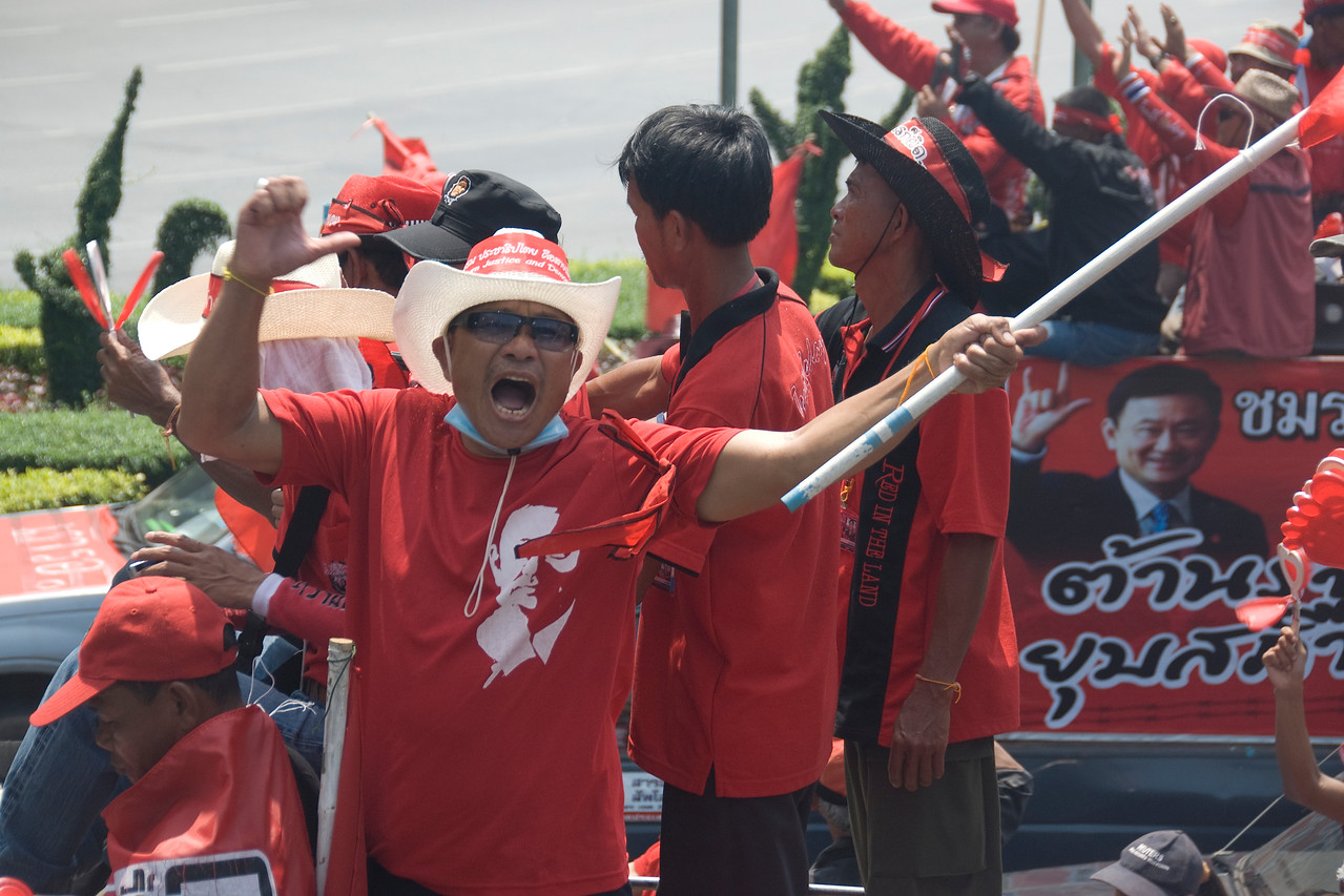 Man waving flag during the Red Shirt Protest in Thailand