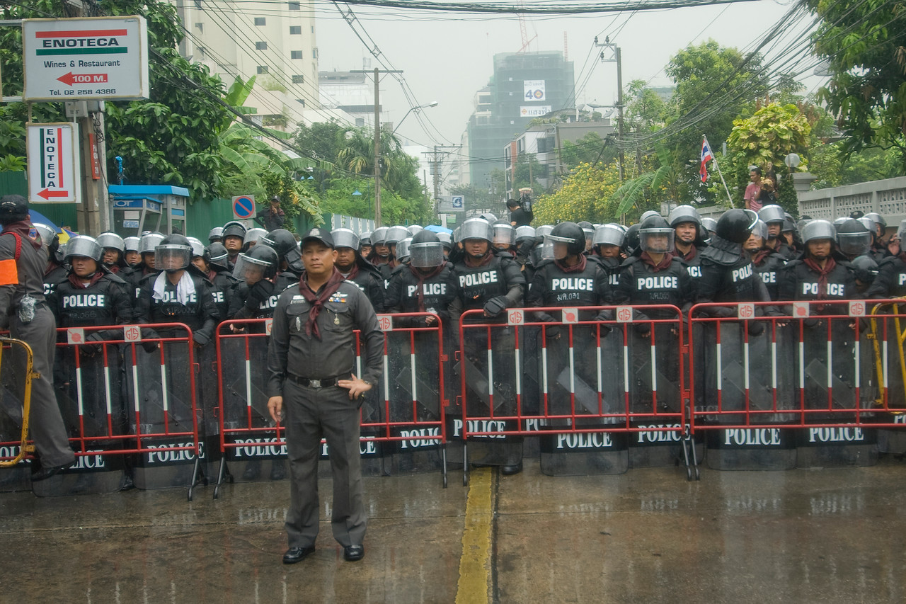 The riot police forming a barricade against Red Shirt protesters