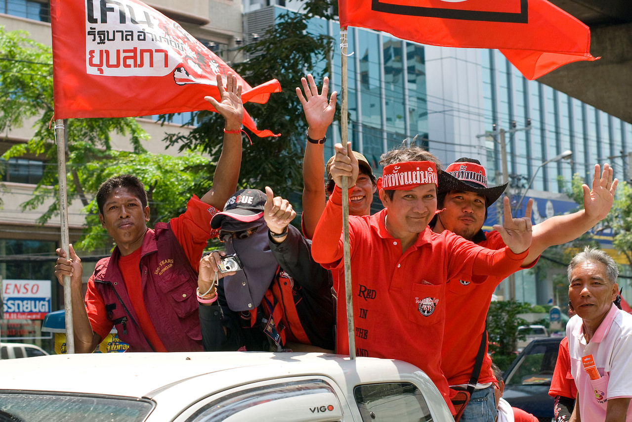 Protesters waving to the camera in Thailand's Red Shirt Protest