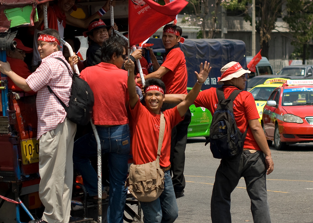 Protesters smiling to the camera during Red Shirt Protest in Thailand