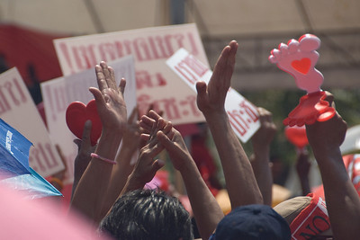 Hands being held up during Red Shirt Protest in Thailand