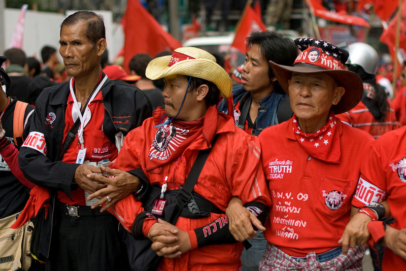 Protesters arm-in-arm during the Red Shirt Protest March in Thailand