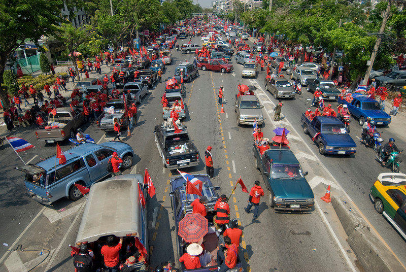 Street filled with vehicles joining the Red Shirt Protest march - Thailand